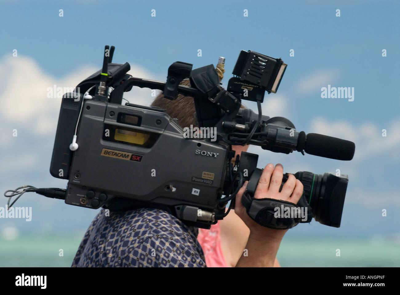 Videografo e alla fotocamera Immagini Stock