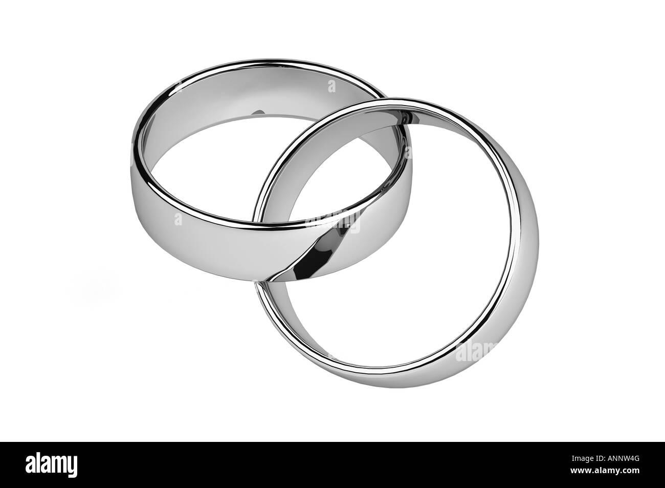 Interbloccato argento anelli di nozze Immagini Stock