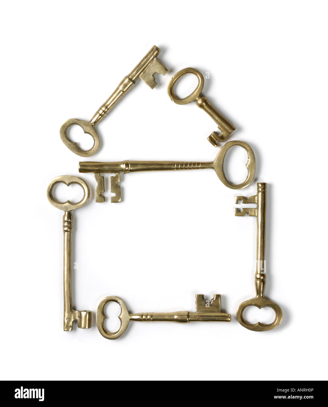 Il simbolo Home realizzata in ottone lucido chiavi dello scheletro Immagini Stock