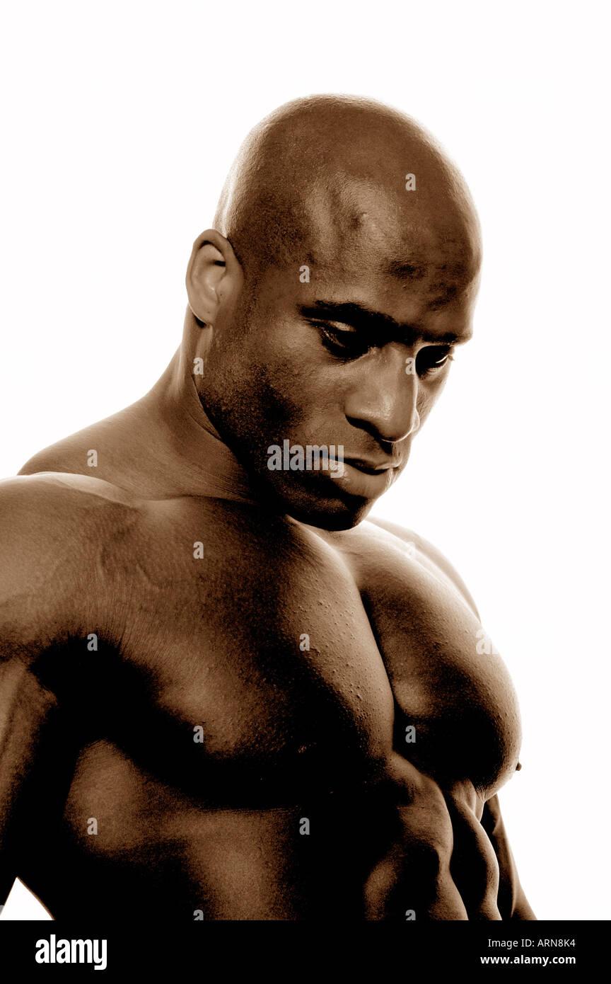 Il viso e la parte superiore del corpo di un forte uomo nero Immagini Stock