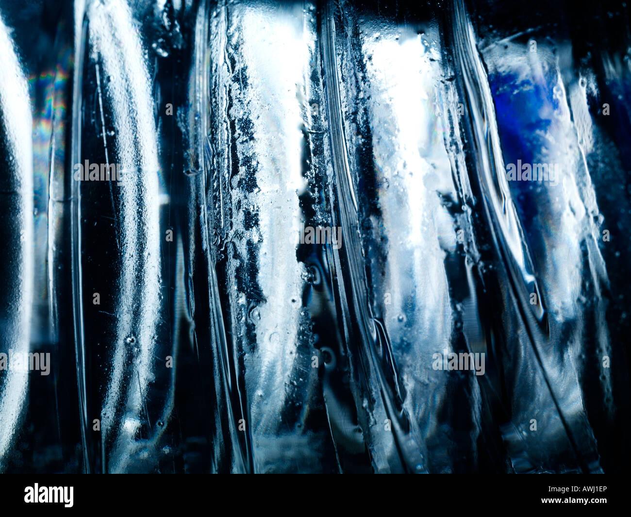 Arte astratta di immagini di file di grandi dimensioni di una bottiglia di plastica illuminato con una sorgente Immagini Stock
