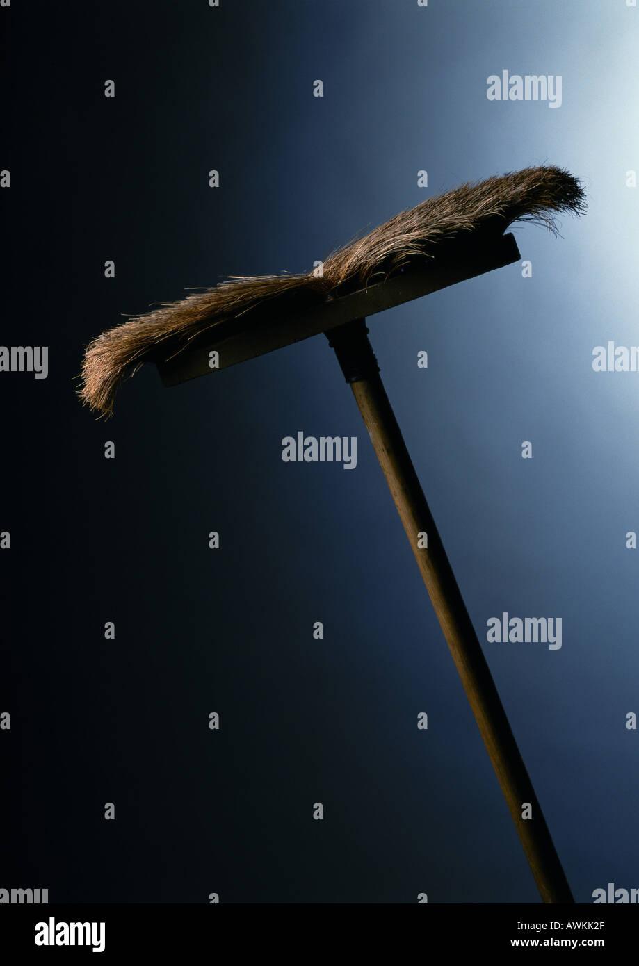 Usurati scopa Immagini Stock