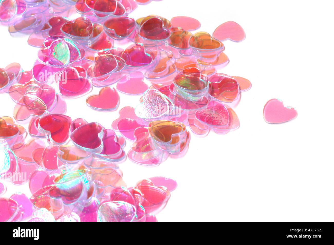 Colorate a forma di cuore coriandoli Immagini Stock
