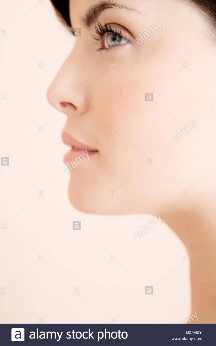 Profilo del giovane volto di donna Immagini Stock