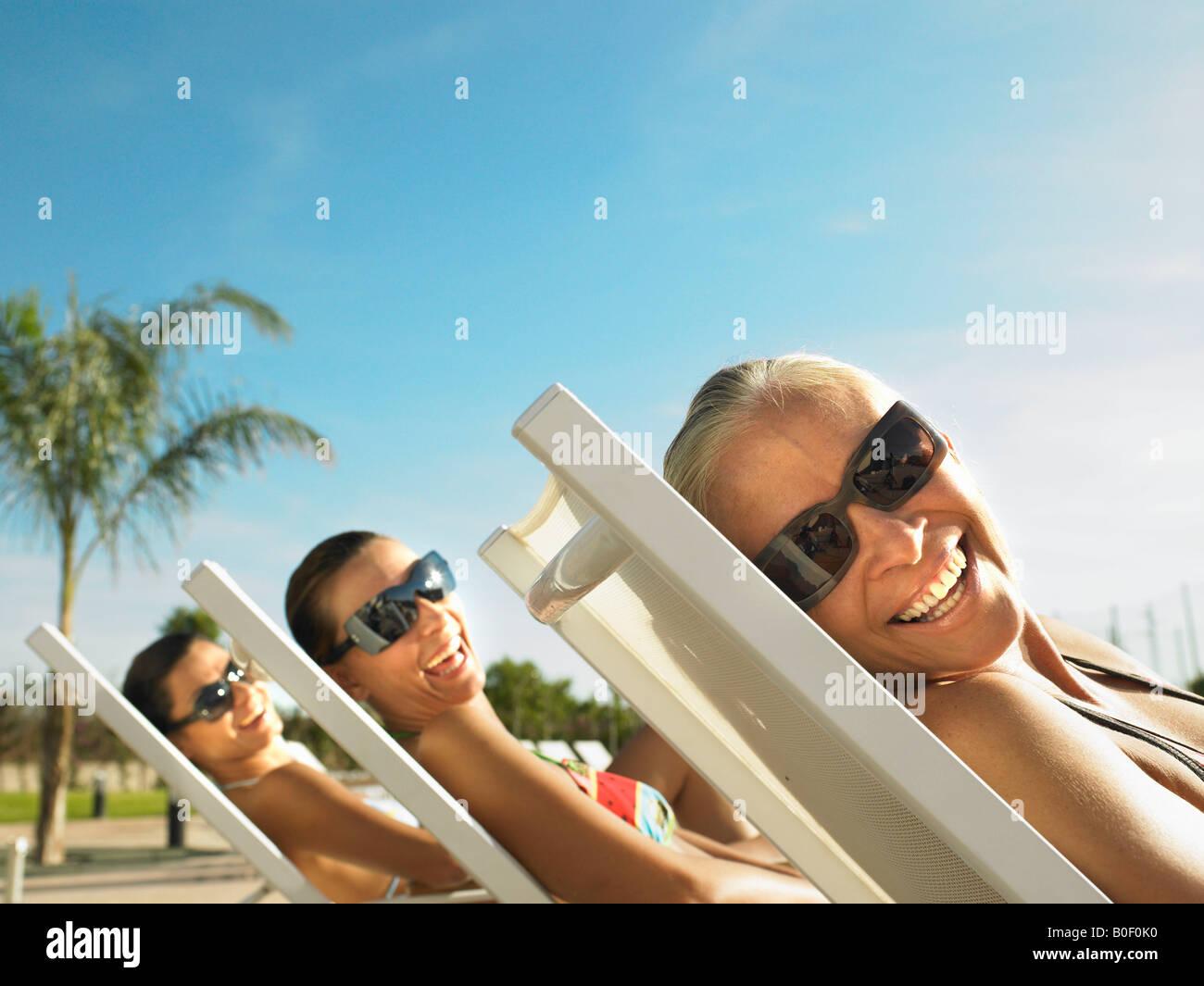 Tre Signori di relax al sole Immagini Stock