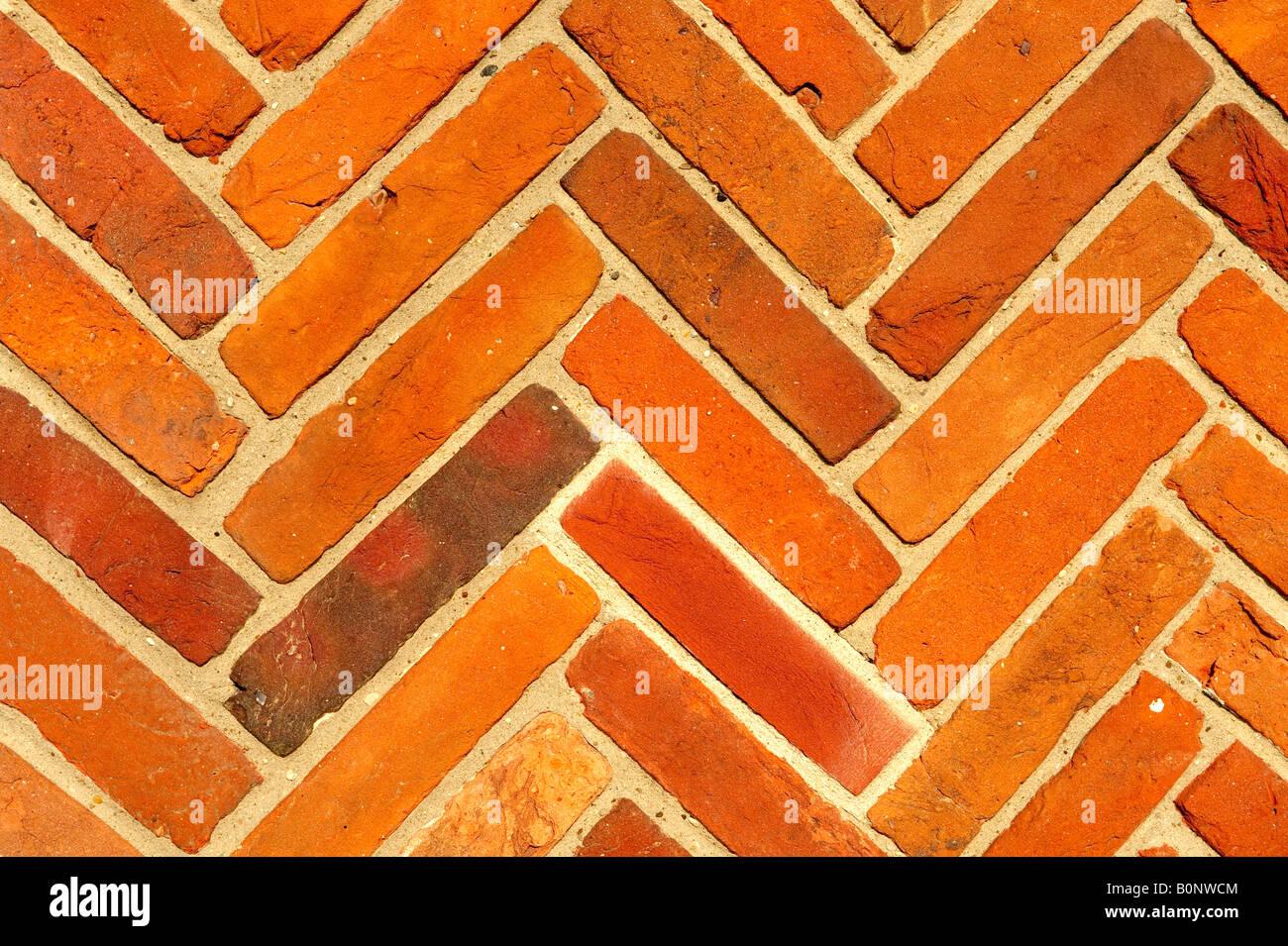 Close up Elizabethan mattoni rossi a lisca di pesce pattern Foto Stock