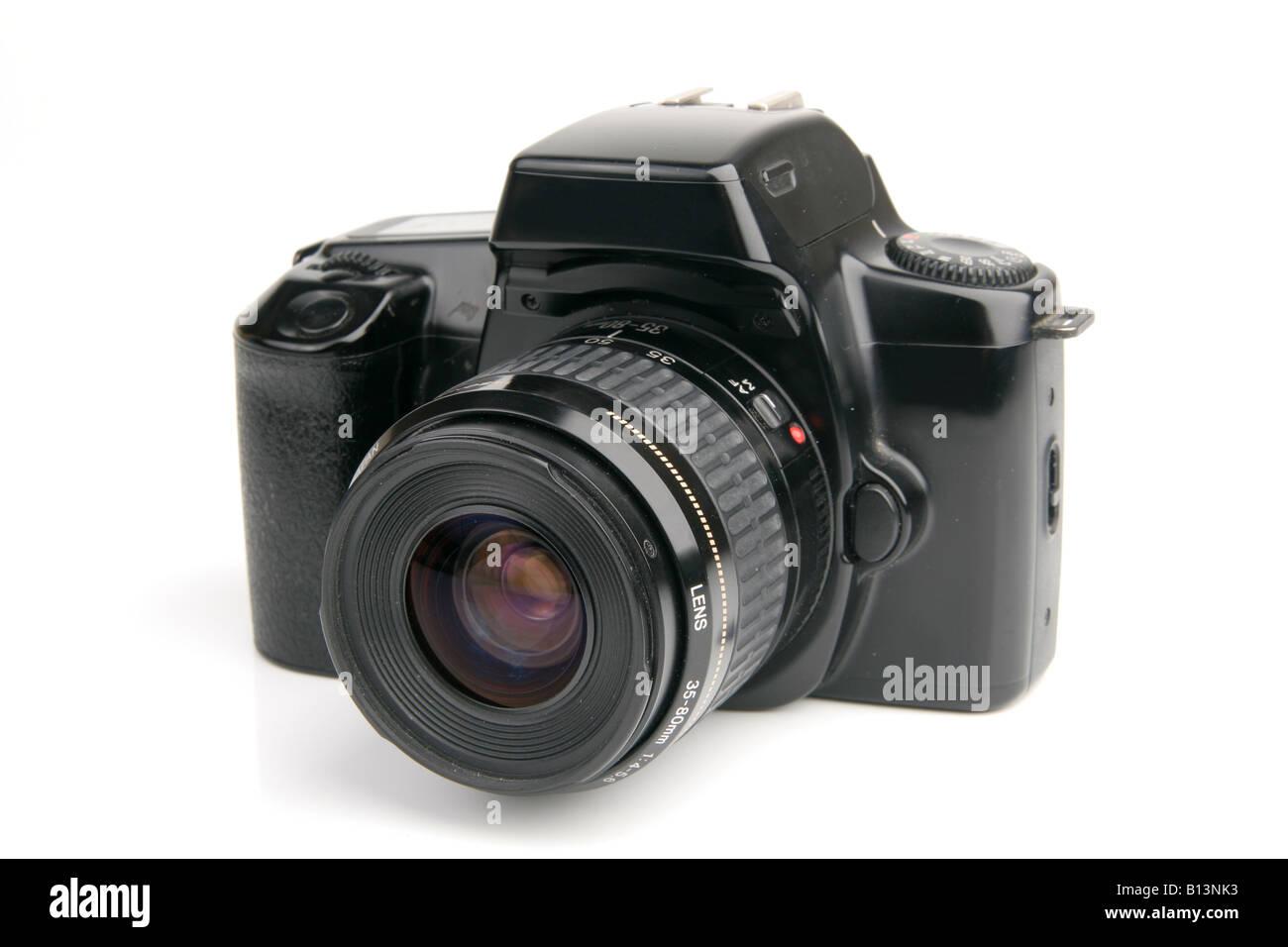 Fotocamera reflex su bianco Immagini Stock