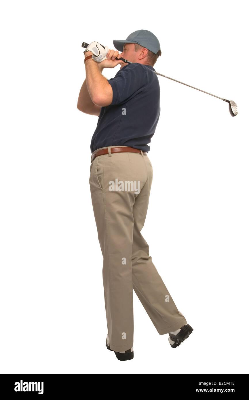Studio shot di un golfista a guardare la sua palla volo Immagini Stock