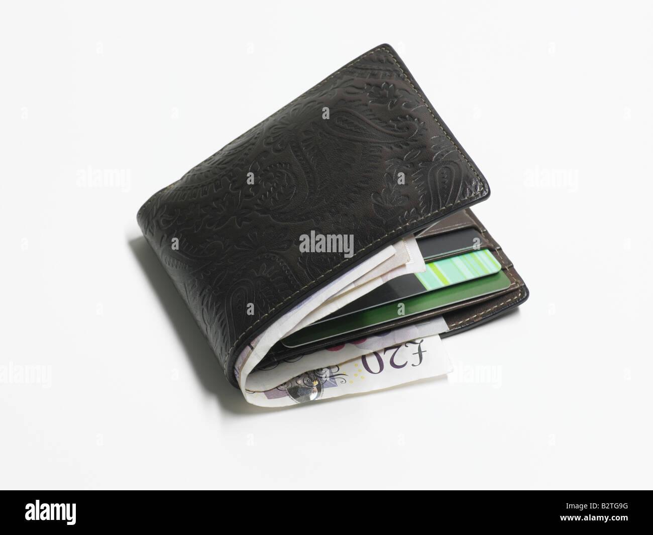 Il rigonfiamento portafoglio con moneta di Stirling Foto Stock
