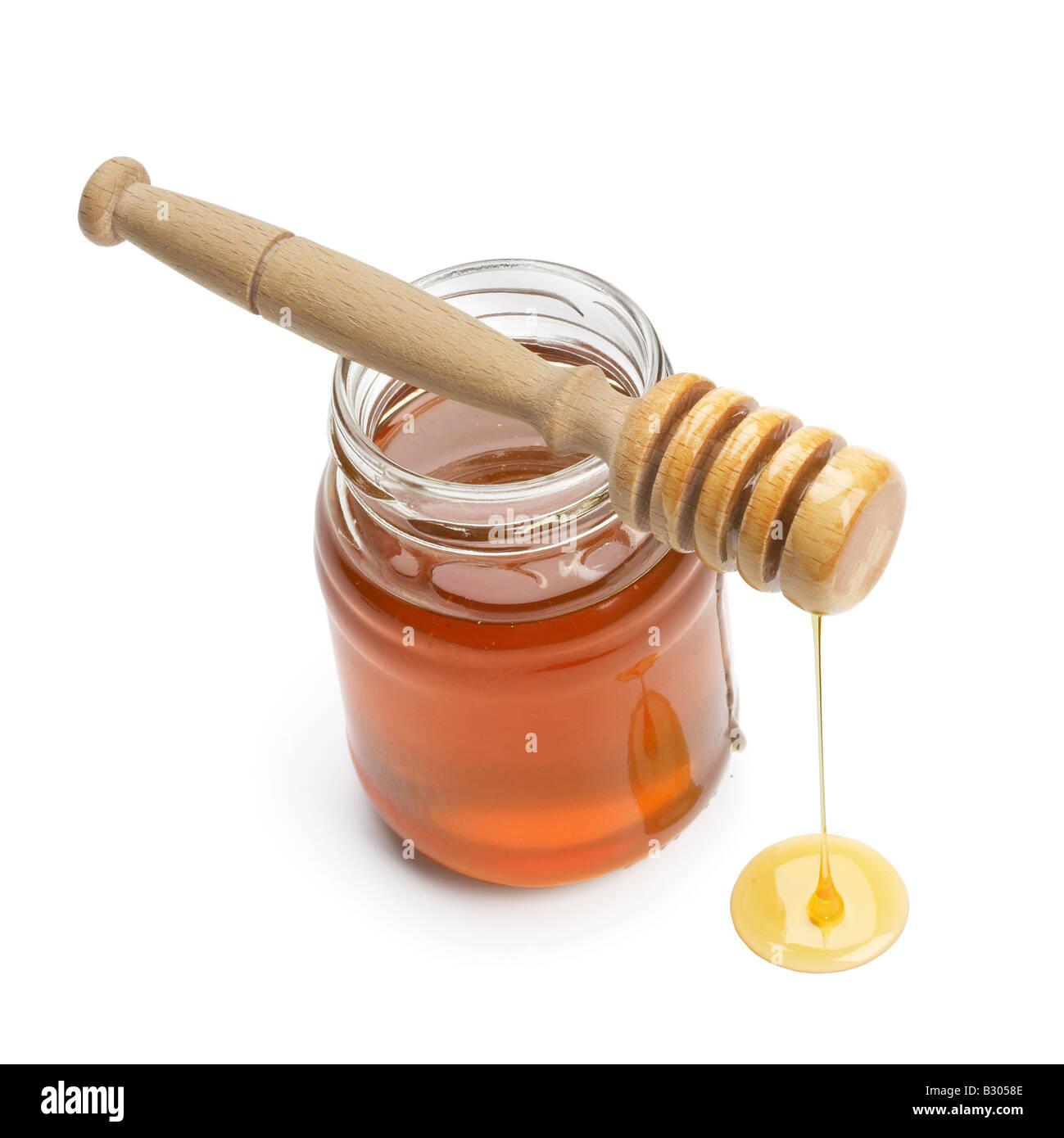 Un vasetto di miele con drizzler Immagini Stock