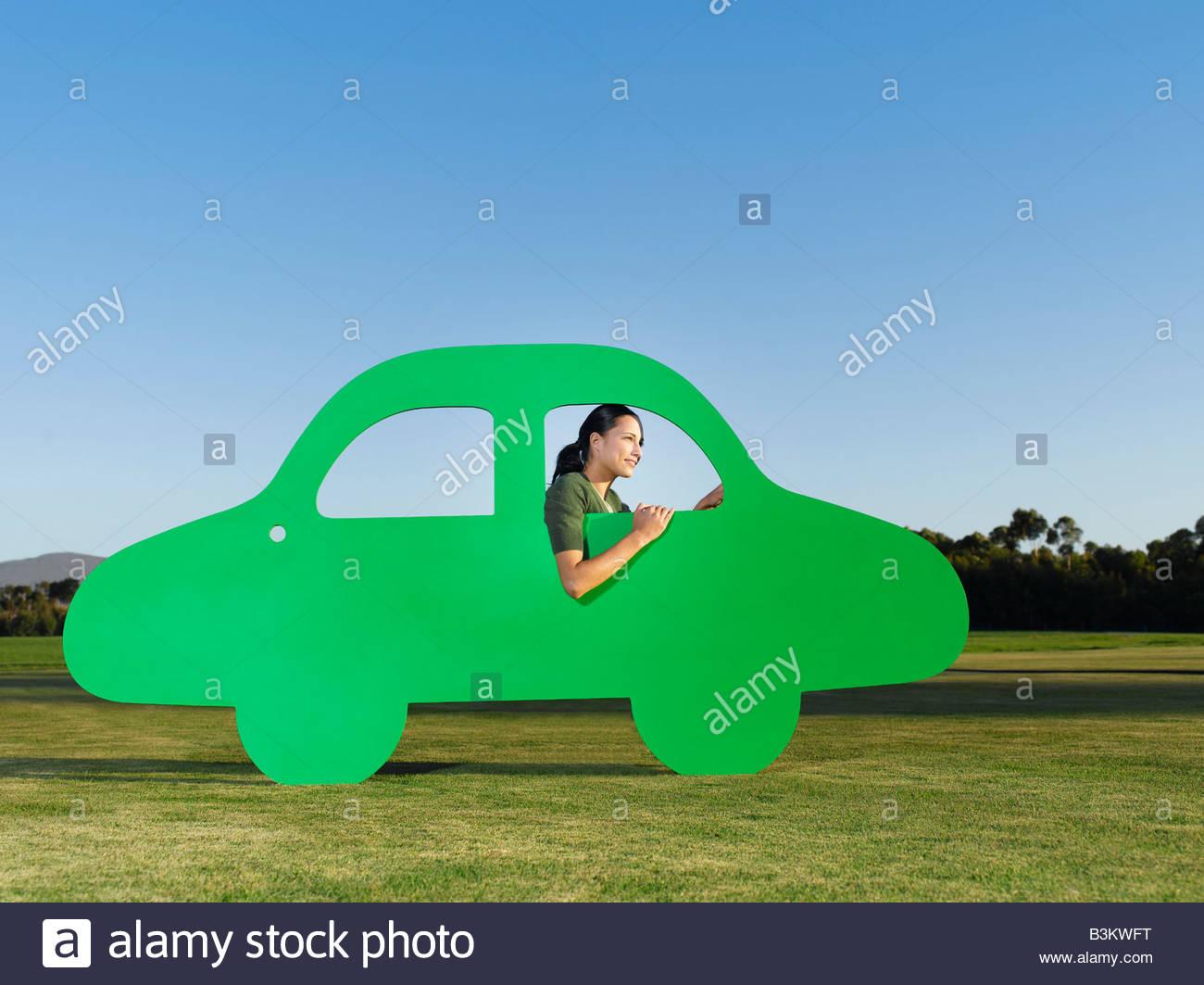 Donna alla guida di auto esclusione Immagini Stock