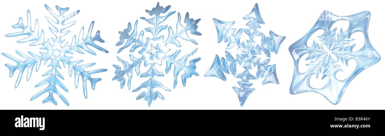 Quattro i fiocchi di neve su sfondo bianco Immagini Stock