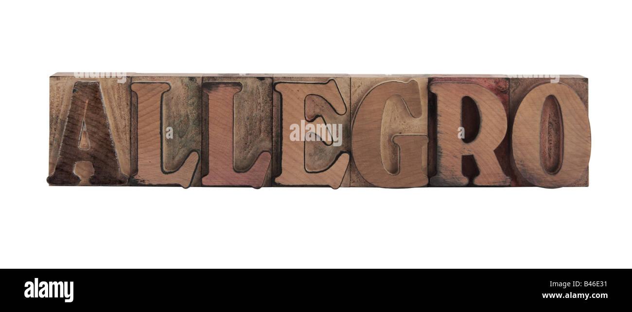"""La parola """"allegro"""" nella vecchia, inchiostro colorato tipo di legno Immagini Stock"""