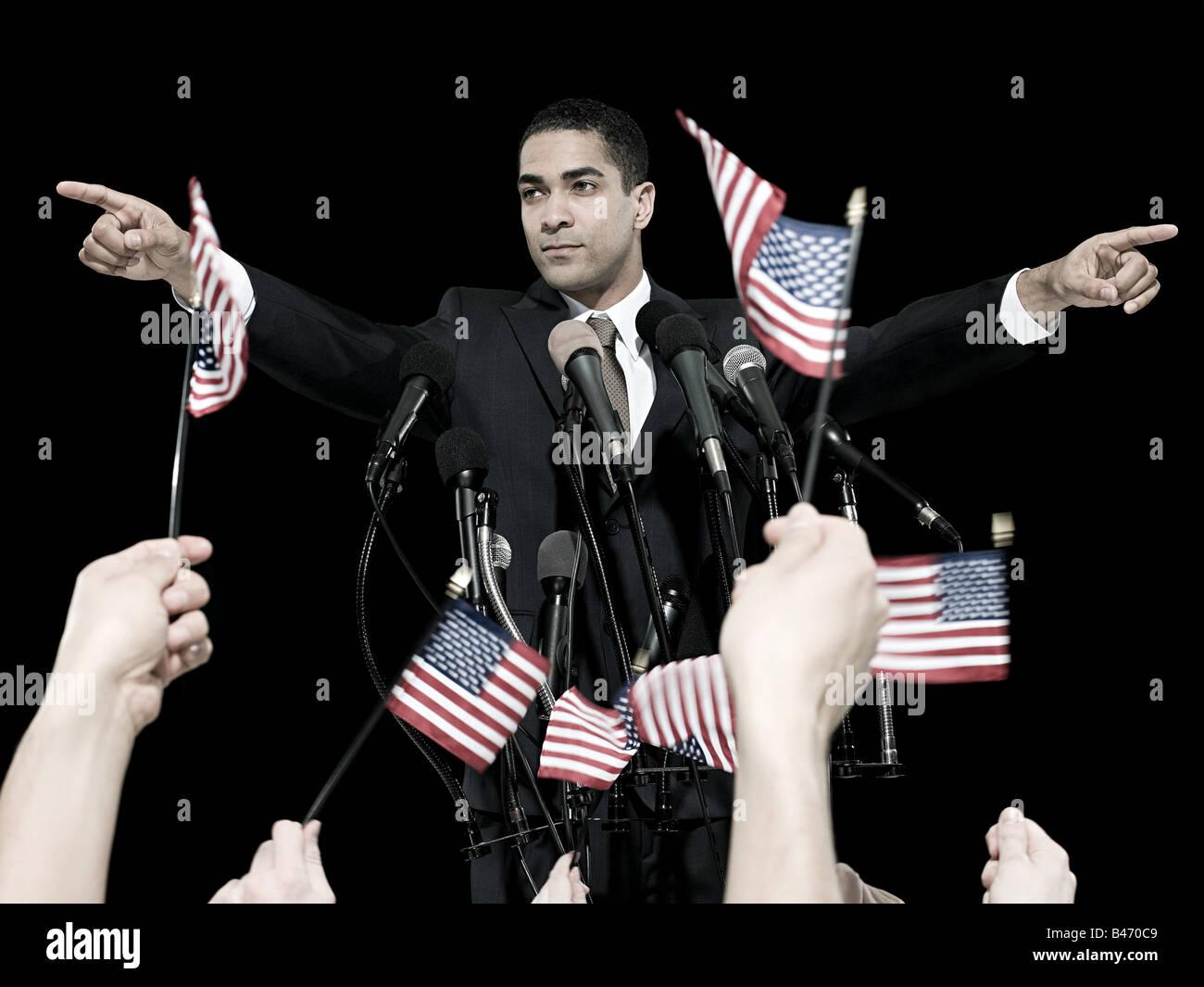 Uomo politico e sostenitori Immagini Stock