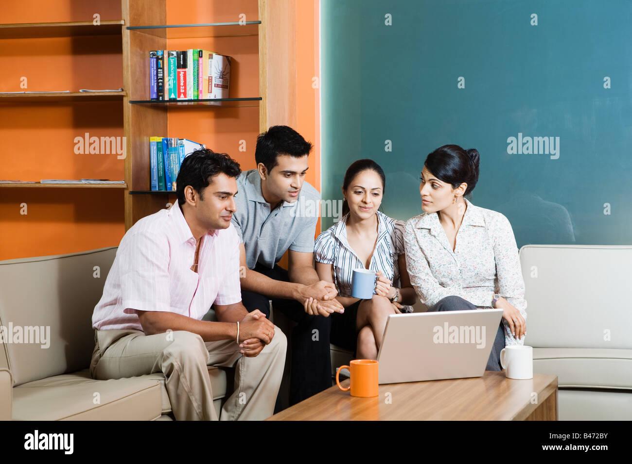 Quattro indiani colleghi di ufficio Immagini Stock