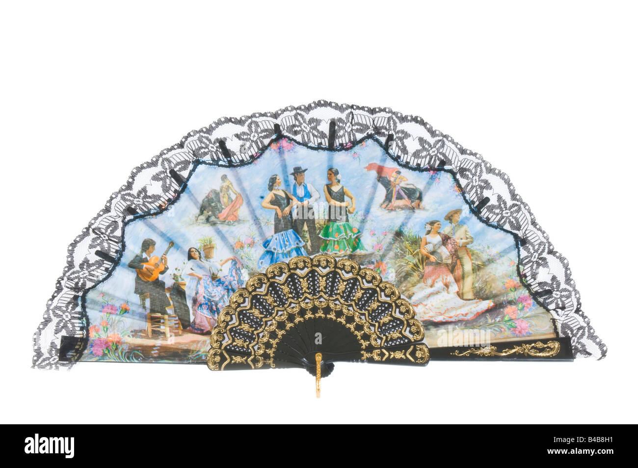 Una mano spagnola detenute fan vacanza economica souvenir su di un bianco puro (255) dello sfondo. Immagini Stock