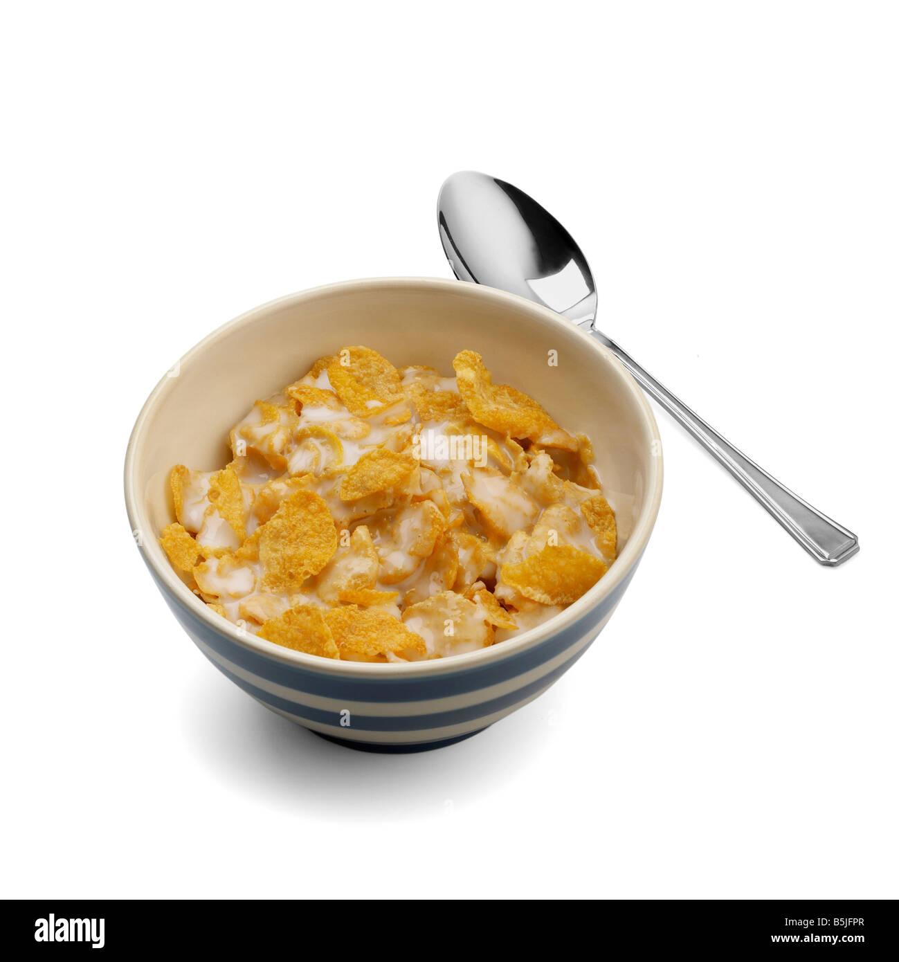 Ciotola di cornflake con cucchiaino Immagini Stock
