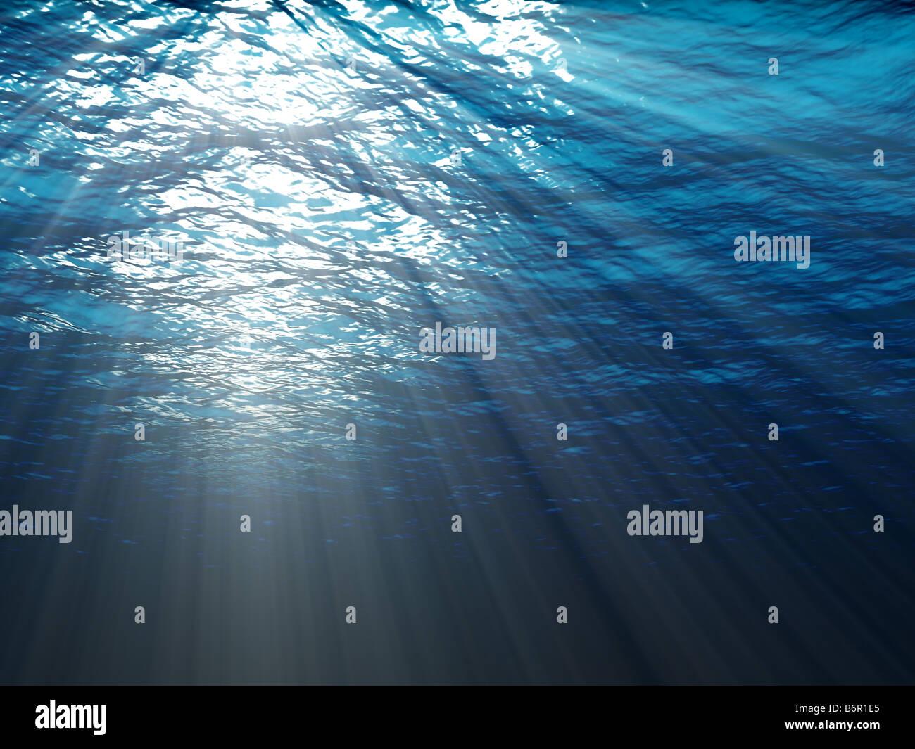 Una scena subacquea con raggi di sole che splende attraverso l'acqua Immagini Stock
