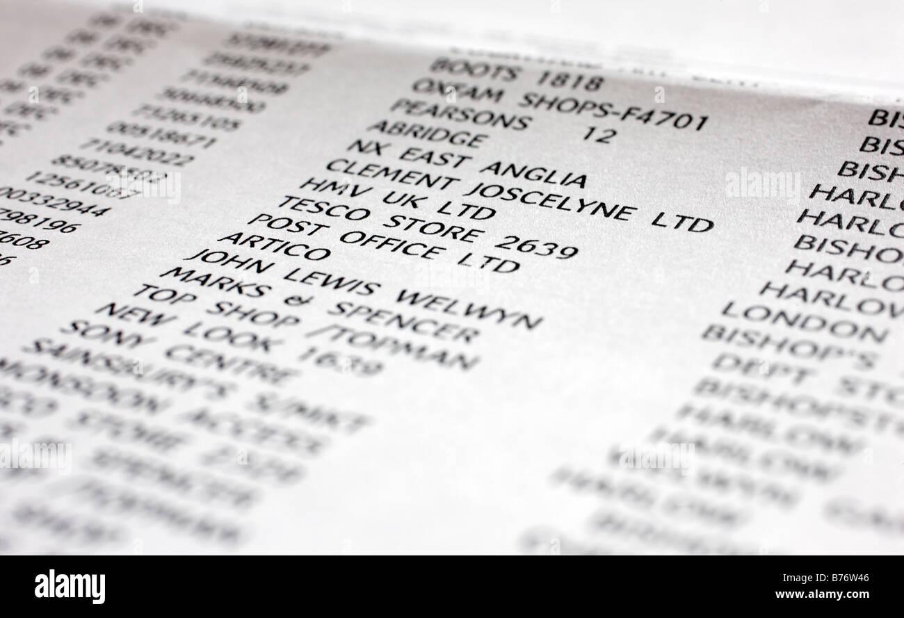 Stampare carta di credito lista di acquisto che mostra le transazioni da negozi su British High Street Immagini Stock