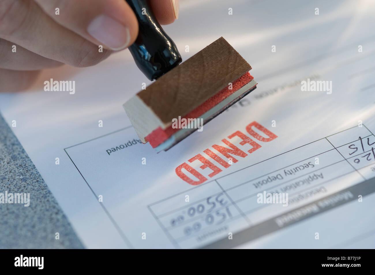 """La timbratura uomo """"negato"""" sulla domanda di credito ipotecario Immagini Stock"""