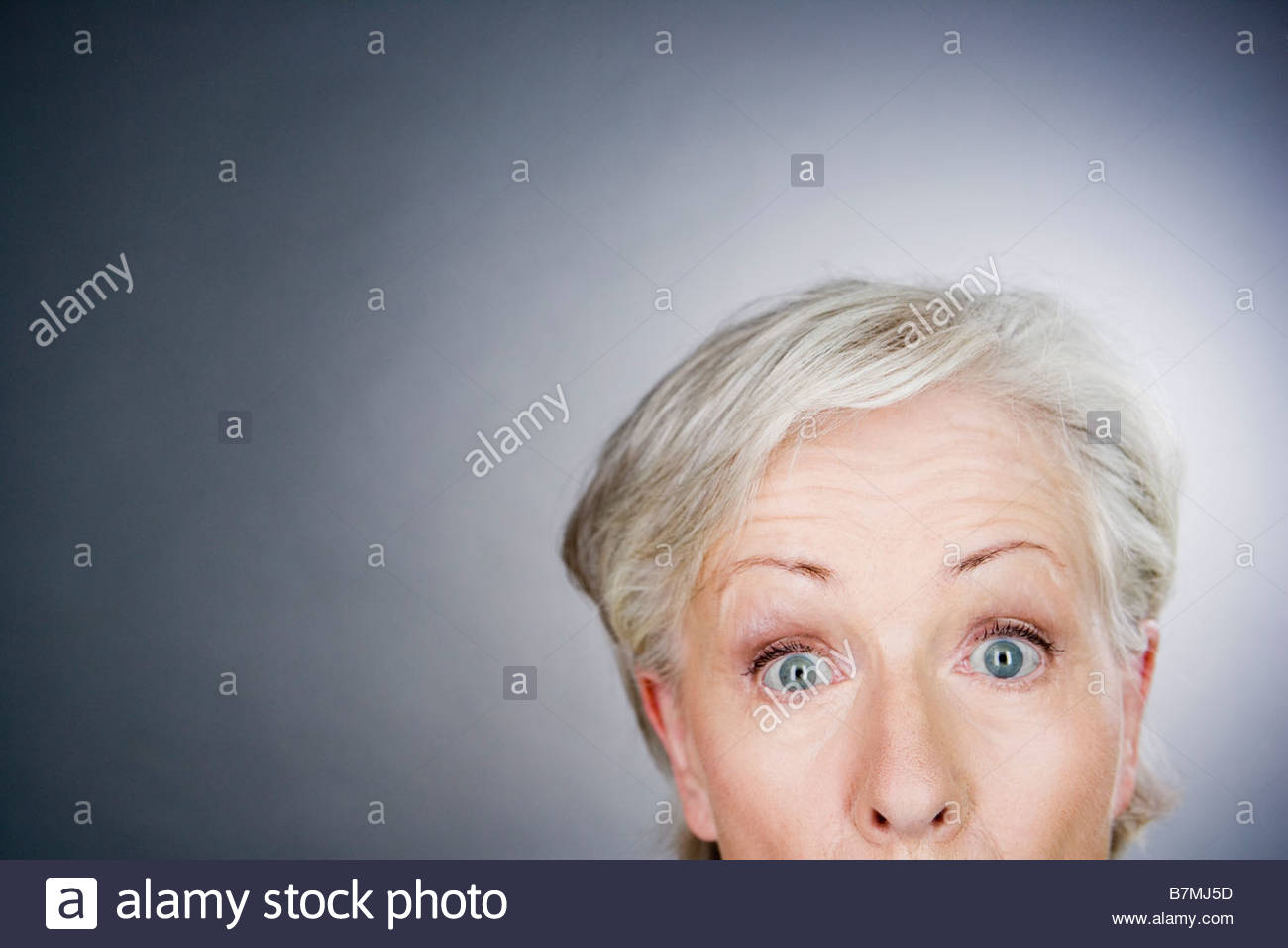 Un senior donna che guarda stupito Immagini Stock