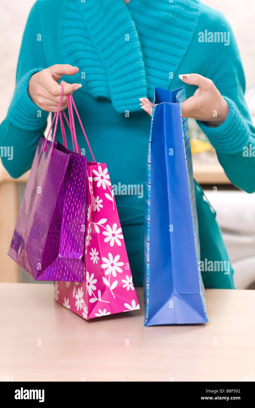 Donna con le borse della spesa Immagini Stock