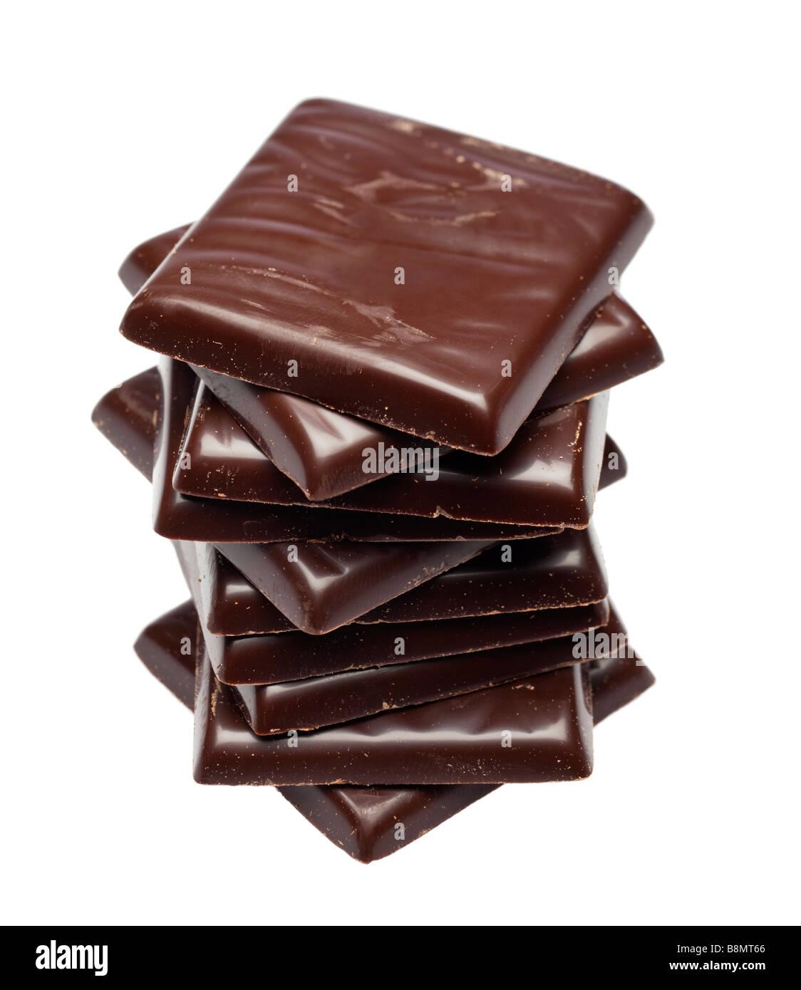 Pila di cioccolato fondente dopo otto zecche cena di ritaglio Immagini Stock