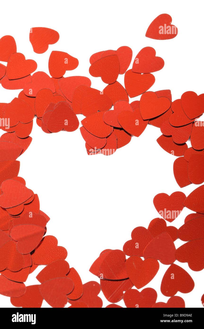 Cuori rossi coriandoli isoleted su sfondo bianco Immagini Stock