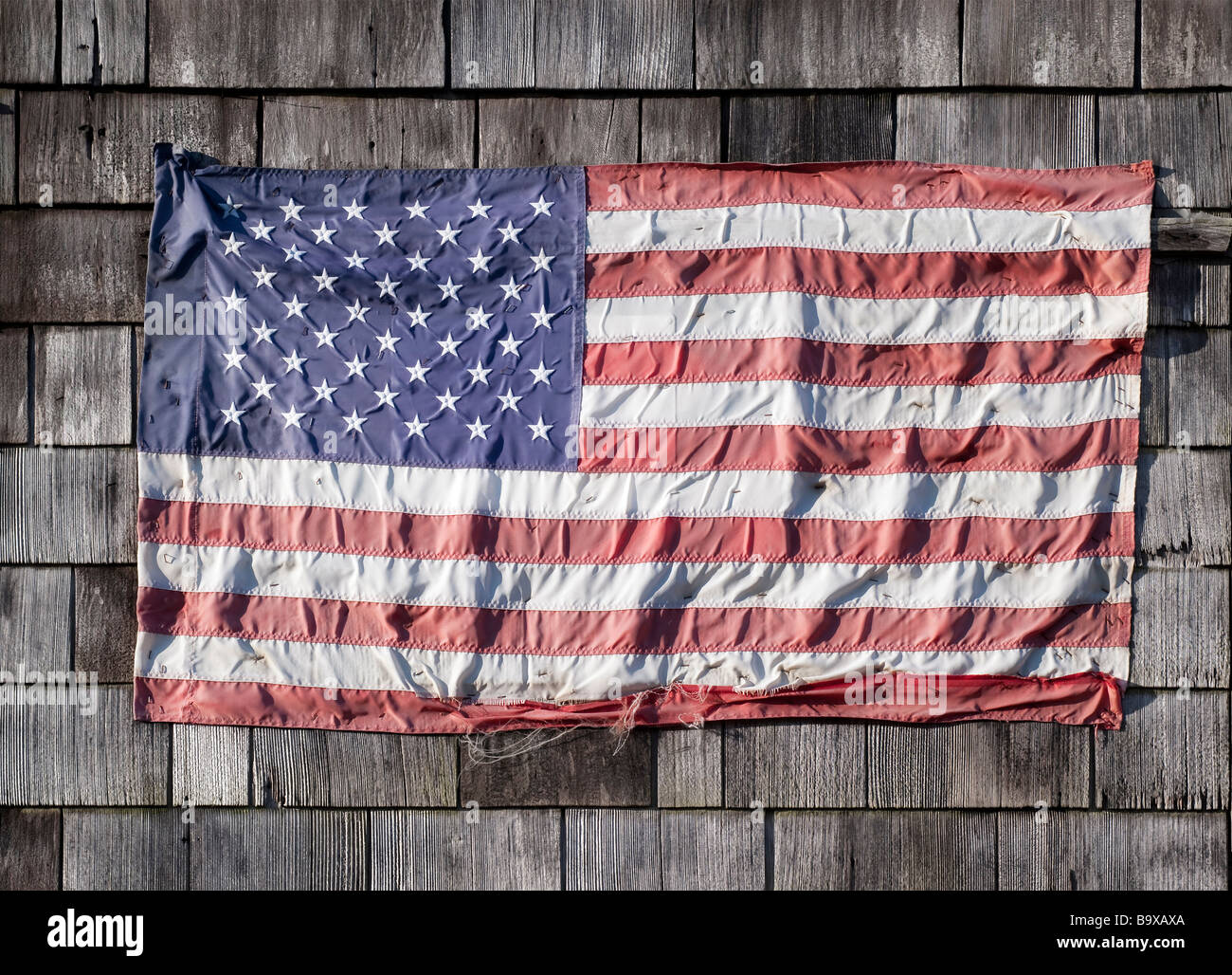 Indossato bandiera americana Immagini Stock