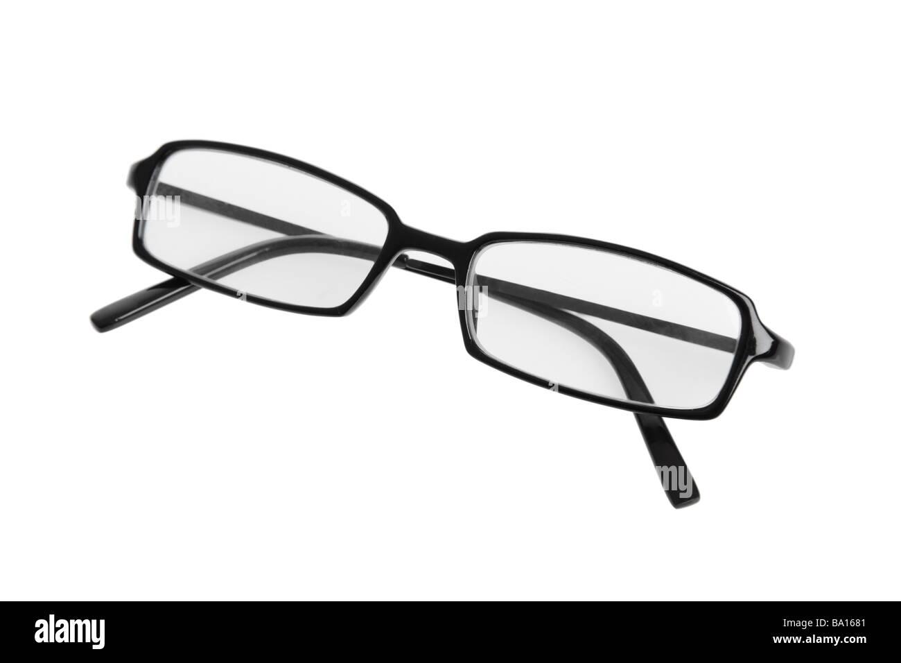 Gli occhiali da lettura intaglio su sfondo bianco Immagini Stock