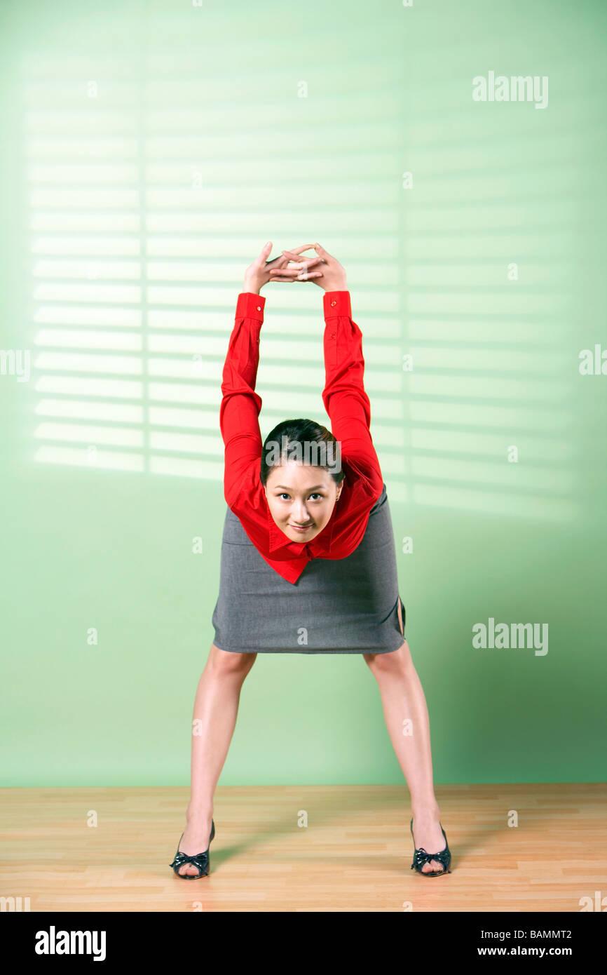 Imprenditrice Stretching Immagini Stock