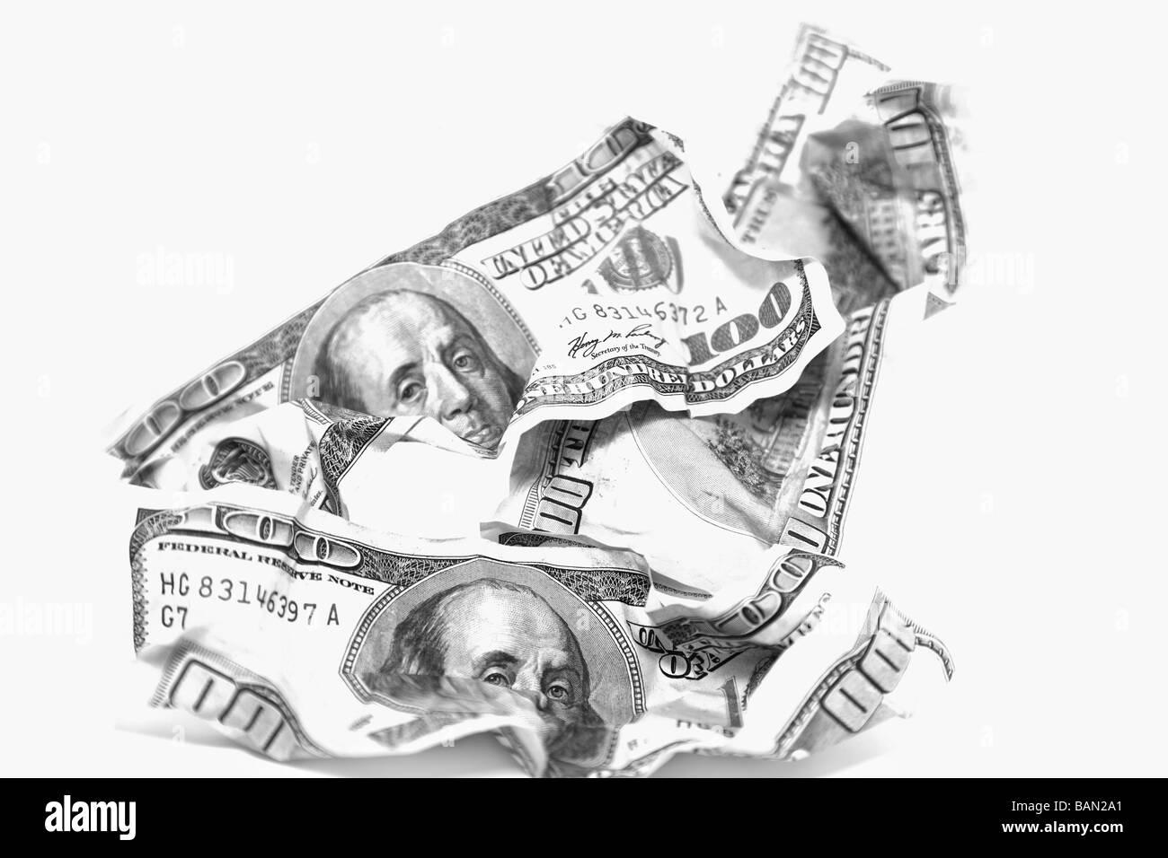 Di dollari contro uno sfondo bianco Foto Stock