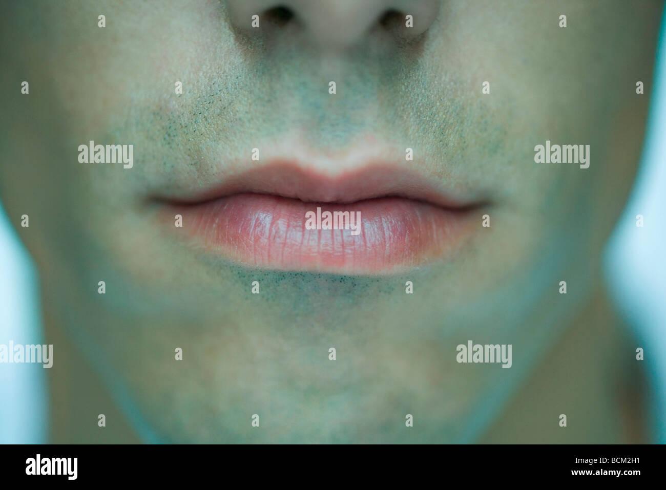Uomo di labbra, close-up Immagini Stock