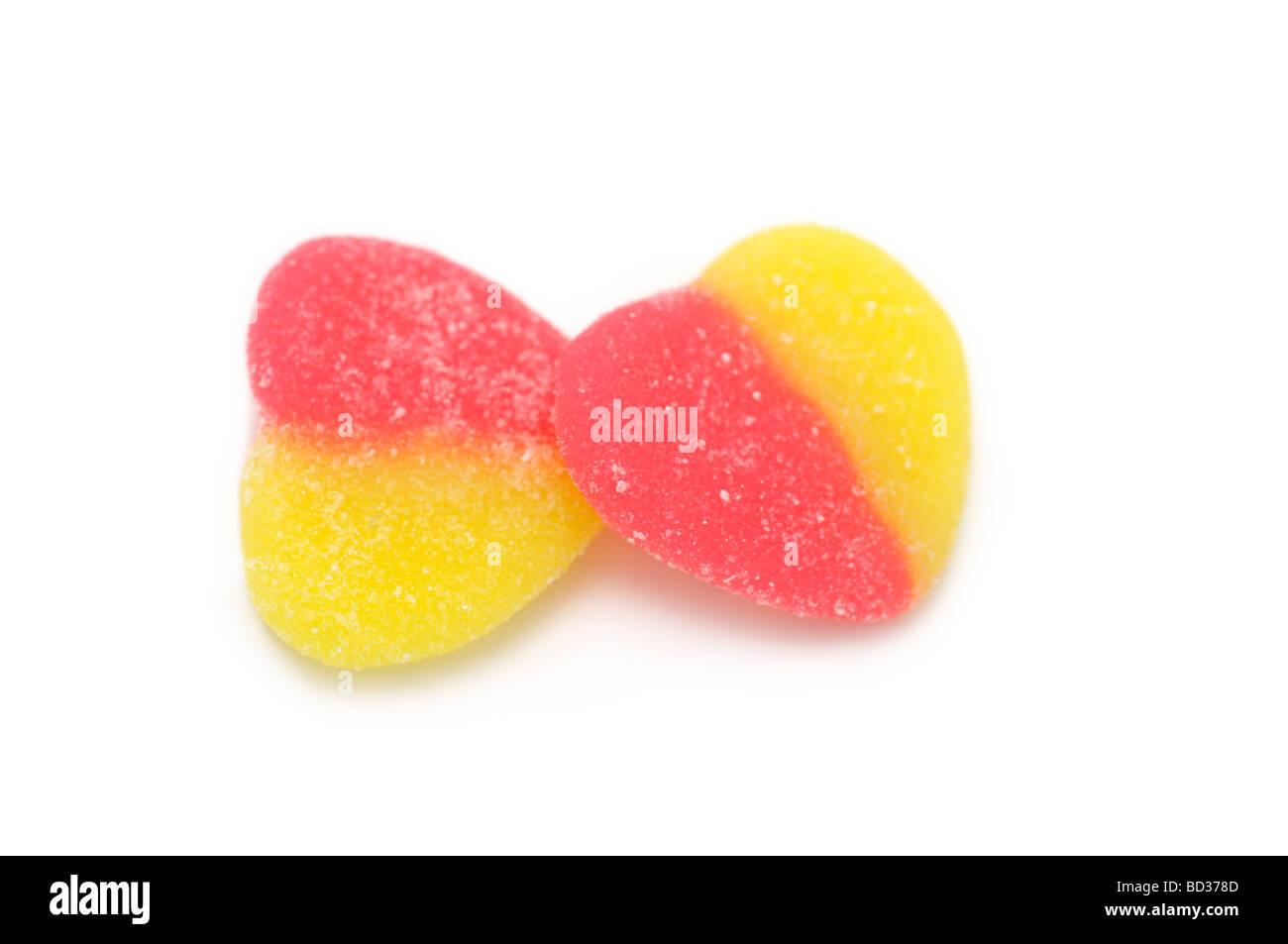 Coppia di a forma di cuore ad caramelle gommose, rivestite di zucchero Immagini Stock