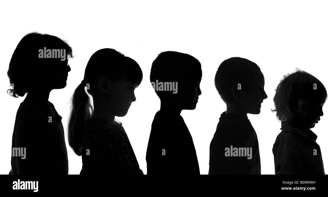 Cinque diversi bambini shot in stile Silhouette Immagini Stock