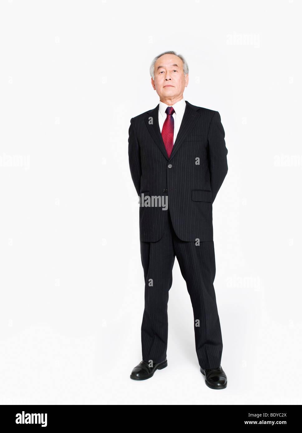 Una piena lunghezza Ritratto di un uomo asiatico Immagini Stock