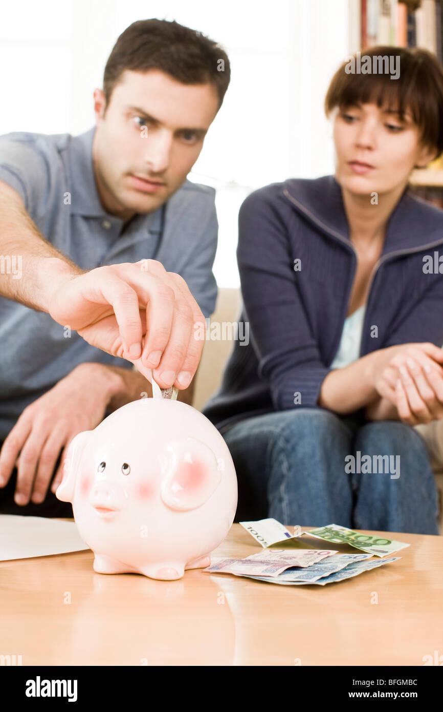 Paio di risparmio di denaro Immagini Stock