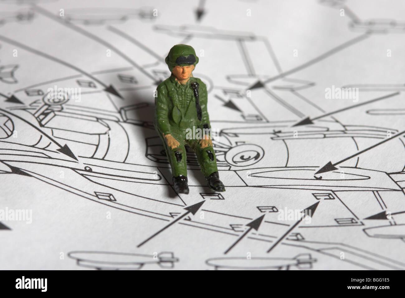 Toy piano approssimativamente verniciato seduta pilota sul kit di costruzione con le istruzioni Immagini Stock
