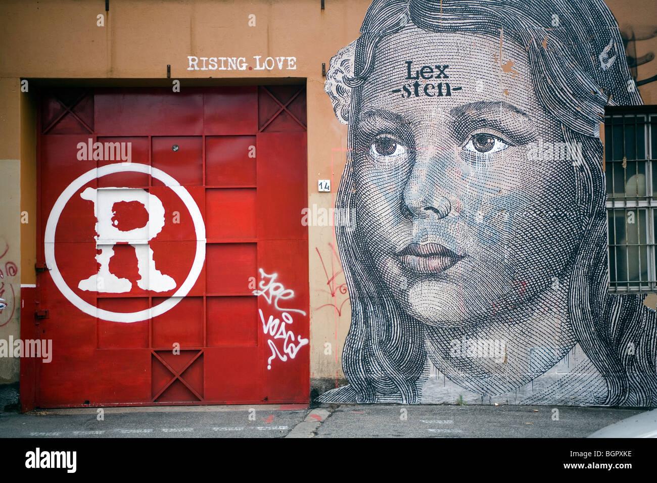 Amore ascendente disegnare graffiti su un muro di Roma, Italia Immagini Stock