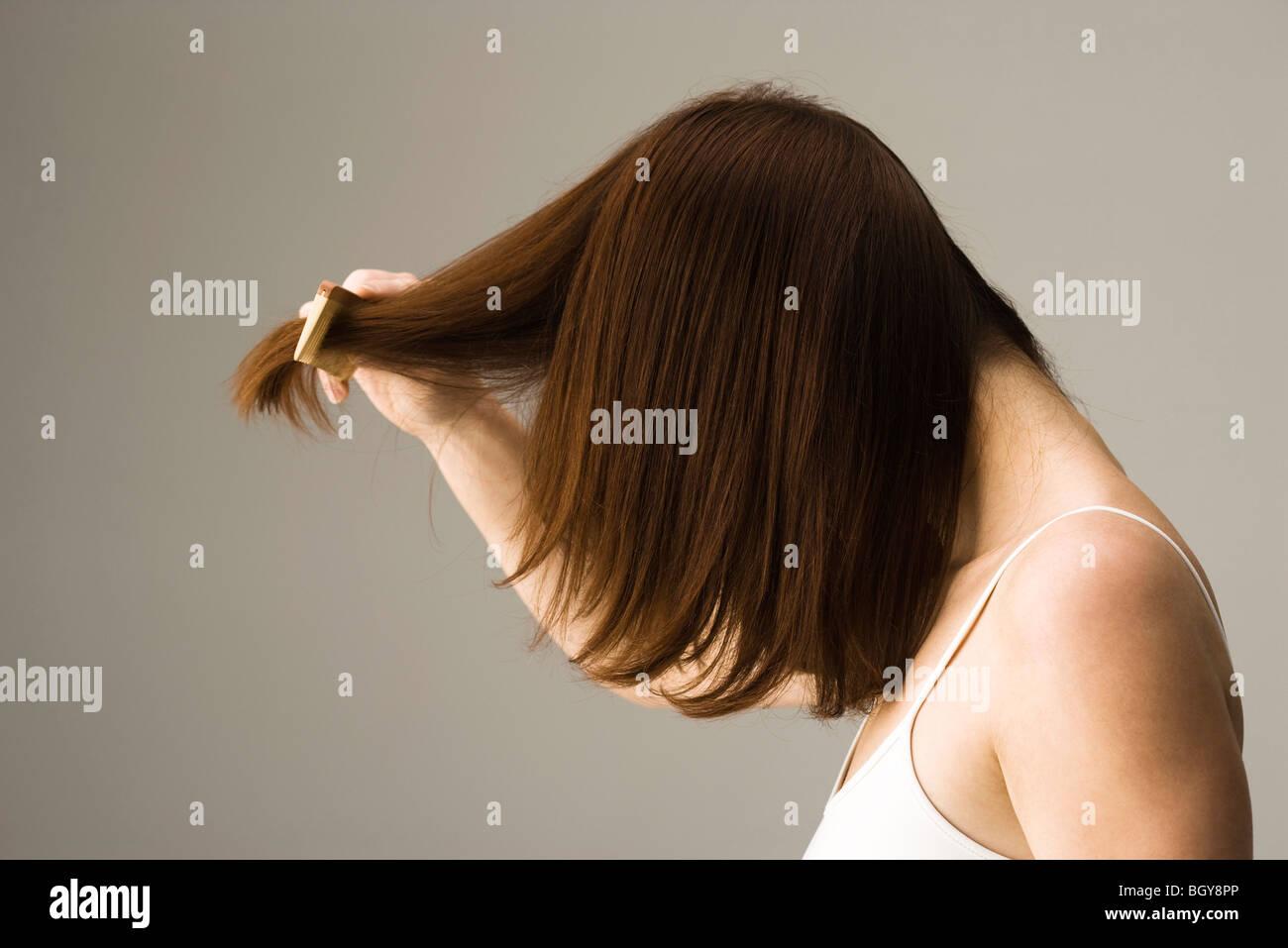 Donna capelli pettinatura Immagini Stock