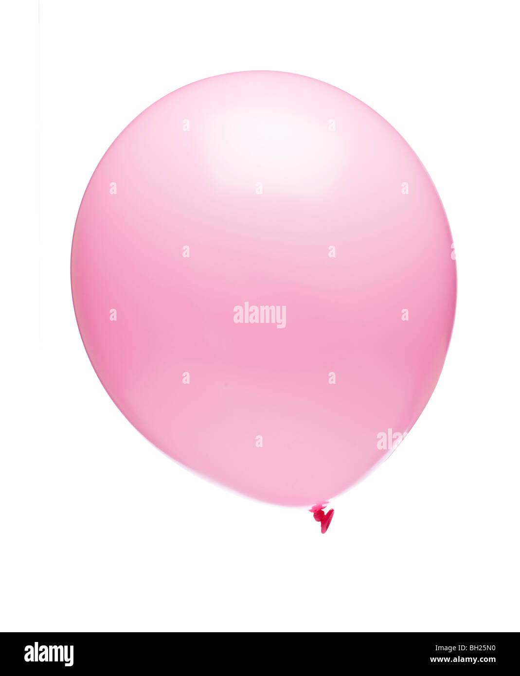 Palloncino rosa su sfondo bianco Foto Stock