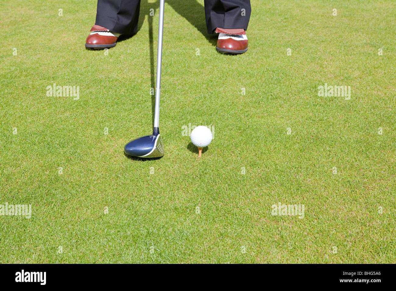 Immagine ritagliata di un giocatore di golf Immagini Stock