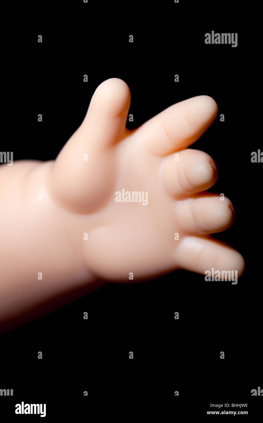 mano di bambole Immagini Stock