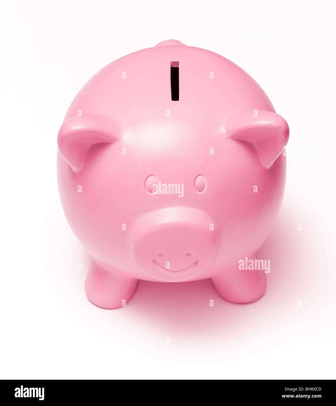 Faccia felice rosa salvadanaio su sfondo bianco Immagini Stock