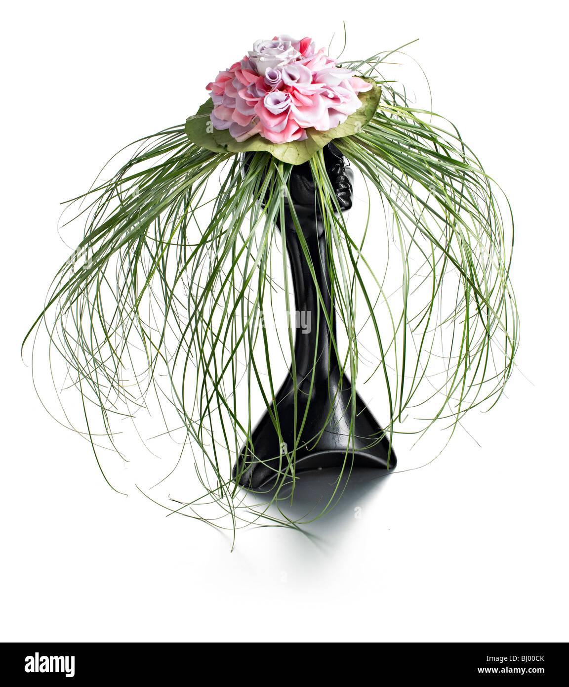 Erba e fiori in hat Ascot ladies giorno Immagini Stock
