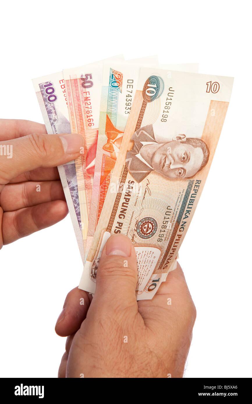 Maschio di denaro mano azienda manciata di valuta delle Filippine Immagini Stock