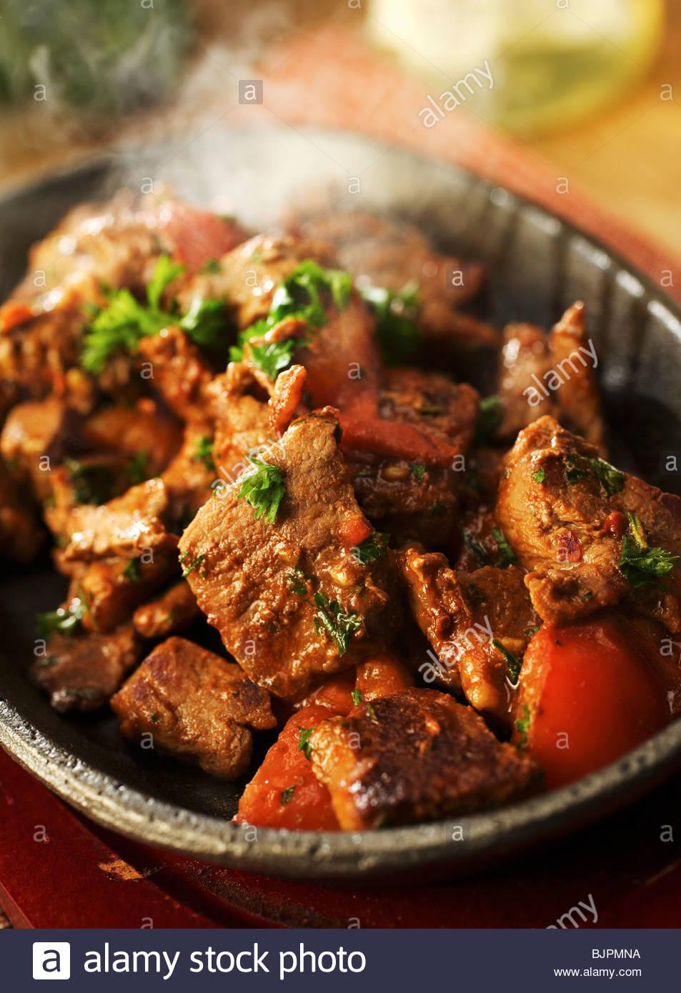 Spicy stufato di agnello con pomodori Immagini Stock