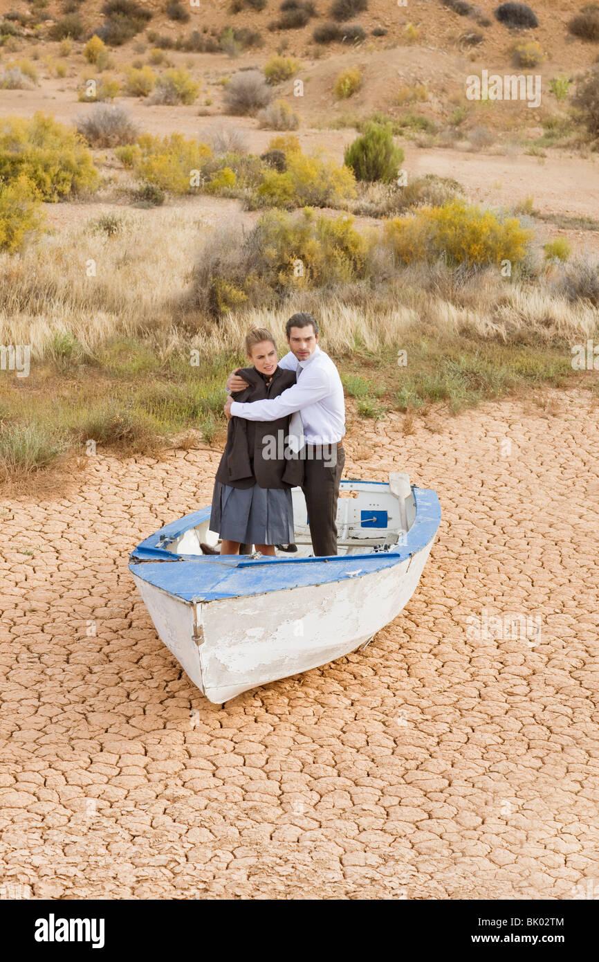 Business-giovane perso nel deserto Immagini Stock