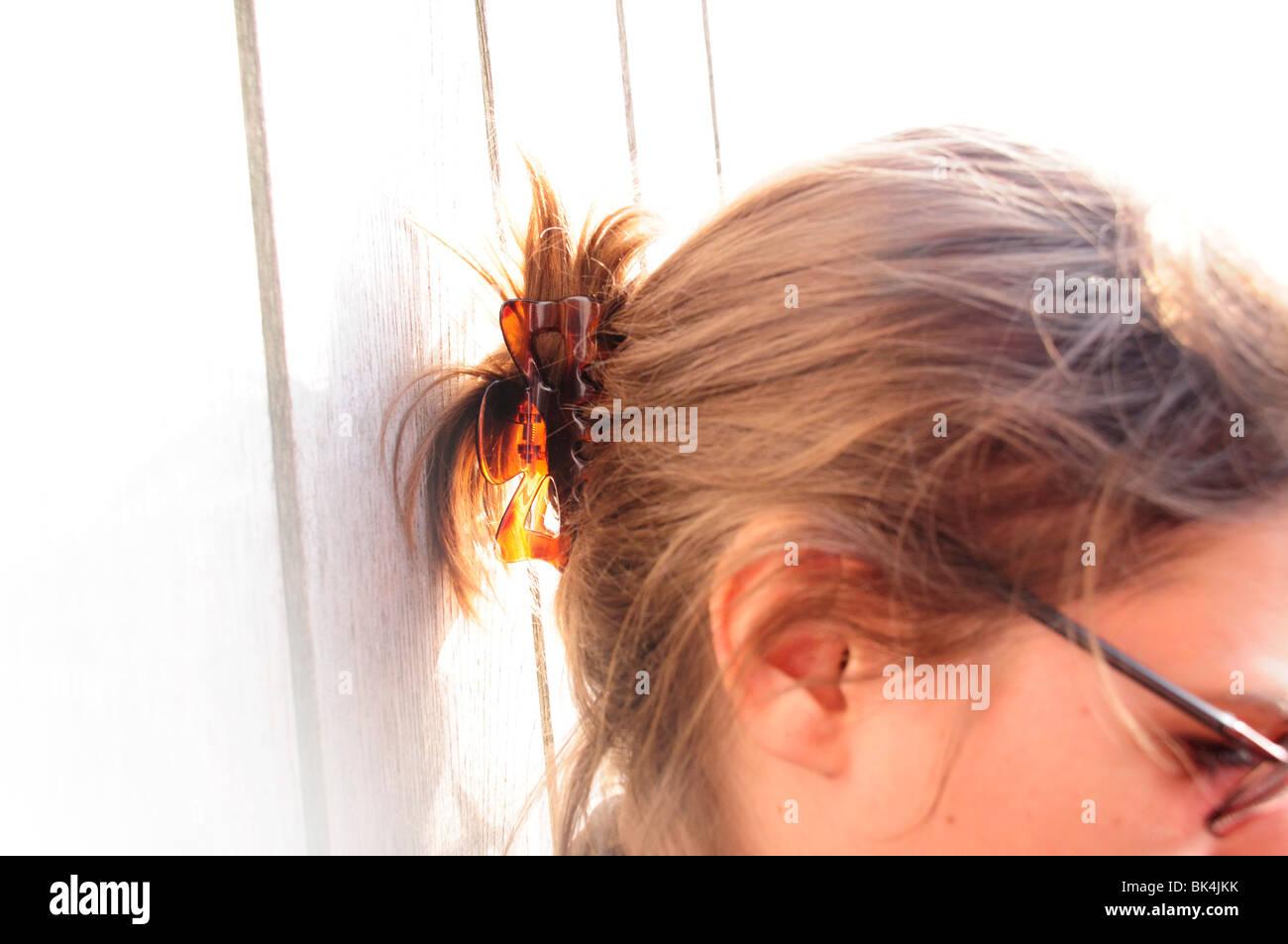 Profilo della testa di donna e capelli in clip Immagini Stock