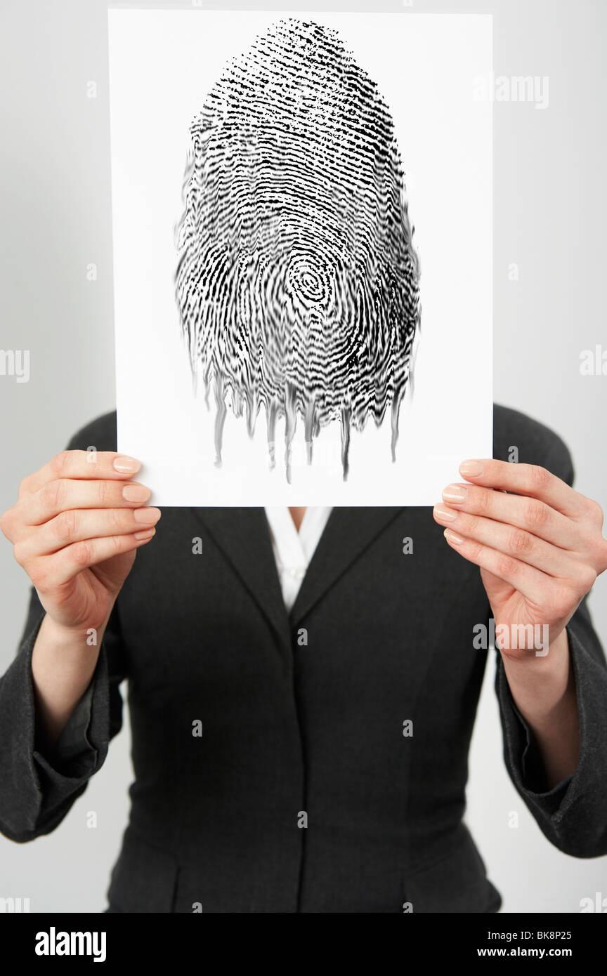 Imprenditrice tenendo una foto di impronte digitali Immagini Stock